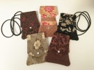 """Mini Travel Purses"" by Pat Leece - Fabric, $35. These unique mini travel purses have a back pocket and three inside pockets.  There are no two alike and they are washable."